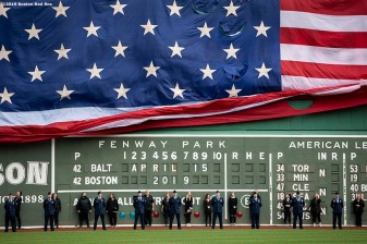 BOSTON, MA - APRIL 15: The American Flag is dropped over the Green Monster before a game between the Boston Red Sox and the Baltimore Orioles on April 15, 2019 at Fenway Park in Boston, Massachusetts. (Photo by Billie Weiss/Boston Red Sox/Getty Images) *** Local Caption ***