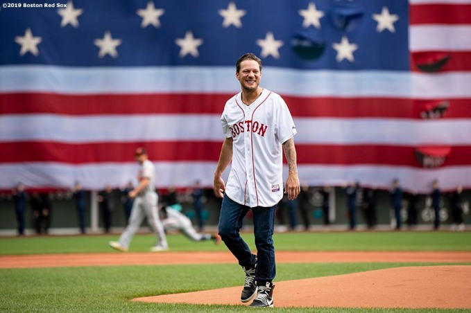 BOSTON, MA - APRIL 15: Former pitcher Jake Peavy of the Boston Red Sox reacts after throwing out a ceremonial first pitch before a game against the Baltimore Orioles on April 15, 2019 at Fenway Park in Boston, Massachusetts. (Photo by Billie Weiss/Boston Red Sox/Getty Images) *** Local Caption *** Jake Peavy