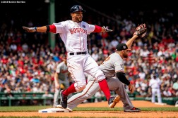 BOSTON, MA - APRIL 15: Xander Bogaerts #2 of the Boston Red Sox gestures as he beats out an infield single caught by Chris Davis #19 of the Baltimore Orioles during the fifth inning of a game on April 15, 2019 at Fenway Park in Boston, Massachusetts. (Photo by Billie Weiss/Boston Red Sox/Getty Images) *** Local Caption *** Xander Bogaerts; Chris Davis
