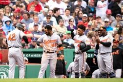 BOSTON, MA - APRIL 15: Chris Davis #19 of the Baltimore Orioles high fives teammates fter hitting a two run home run during the eighth inning of a game against the Boston Red Sox on April 15, 2019 at Fenway Park in Boston, Massachusetts. (Photo by Billie Weiss/Boston Red Sox/Getty Images) *** Local Caption *** Chris Davis