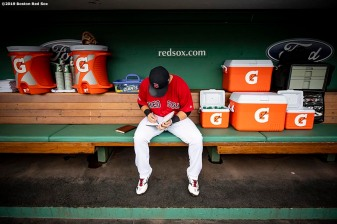 BOSTON, MA - APRIL 23: Michael Chavis #23 of the Boston Red Sox writes in his notebook during his Fenway Park debut before a game against the Detroit Tigers on April 23, 2019 at Fenway Park in Boston, Massachusetts. (Photo by Billie Weiss/Boston Red Sox/Getty Images) *** Local Caption *** Michael Chavis