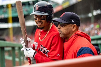 BOSTON, MA - APRIL 23: Mookie Betts #50 of the Boston Red Sox talks with manager Alex Cora during the first inning of a game against the Detroit Tigers on April 23, 2019 at Fenway Park in Boston, Massachusetts. (Photo by Billie Weiss/Boston Red Sox/Getty Images) *** Local Caption *** Mookie Betts; Alex Cora