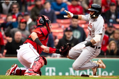 BOSTON, MA - APRIL 23: Christian Vazquez #7 of the Boston Red Sox tags out Nicholas Castellanos #9 of the Detroit Tigers as he attempts to tag up during the ninth inning of a game on April 23, 2019 at Fenway Park in Boston, Massachusetts. (Photo by Billie Weiss/Boston Red Sox/Getty Images) *** Local Caption *** Christian Vazquez; Nicholas Castellanos