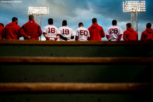 BOSTON, MA - APRIL 24: Members of the Boston Red Sox line up for the National Anthem before a game against the Detroit Tigers on April 24, 2019 at Fenway Park in Boston, Massachusetts. (Photo by Billie Weiss/Boston Red Sox/Getty Images) *** Local Caption ***
