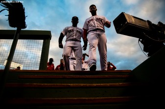 BOSTON, MA - APRIL 24: Jackie Bradley Jr. #19 and J.D. Martinez #28 of the Boston Red Sox walk into the dugout before a game against the Detroit Tigers on April 24, 2019 at Fenway Park in Boston, Massachusetts. (Photo by Billie Weiss/Boston Red Sox/Getty Images) *** Local Caption *** Jackie Bradley Jr.; J.D. Martinez
