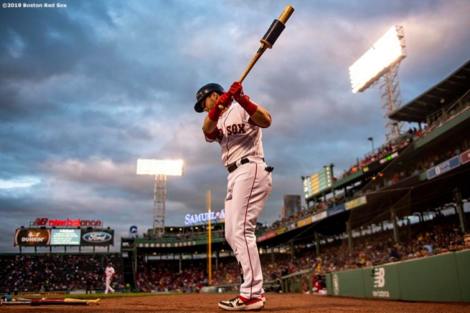 BOSTON, MA - APRIL 24: Andrew Benintendi #16 of the Boston Red Sox warms up on deck during the first inning of a game against the Detroit Tigers on April 24, 2019 at Fenway Park in Boston, Massachusetts. (Photo by Billie Weiss/Boston Red Sox/Getty Images) *** Local Caption *** Andrew Benintendi