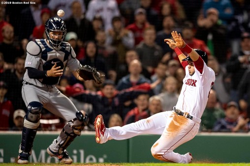 BOSTON, MA - APRIL 24: Michael Chavis #23 of the Boston Red Sox slides as he scores as Grayson Greiner #17 of the Detroit Tigers mishandles a throw during the eighth inning of a game on April 24, 2019 at Fenway Park in Boston, Massachusetts. (Photo by Billie Weiss/Boston Red Sox/Getty Images) *** Local Caption *** Grayson Greiner; Michael Chavis