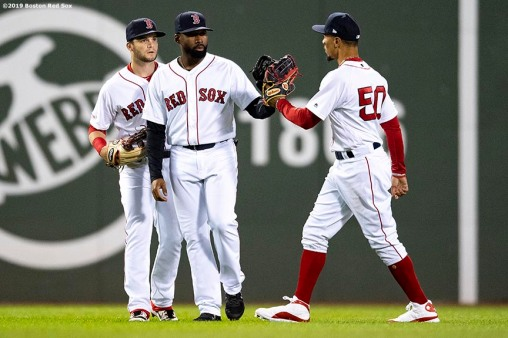 BOSTON, MA - APRIL 24: Andrew Benintendi #16, Jackie Bradley Jr. #19, and Mookie Betts #50 of the Boston Red Sox celebrate a victory against the Detroit Tigers on April 24, 2019 at Fenway Park in Boston, Massachusetts. (Photo by Billie Weiss/Boston Red Sox/Getty Images) *** Local Caption *** Andrew Benintendi; Mookie Betts; Jackie Bradley Jr.