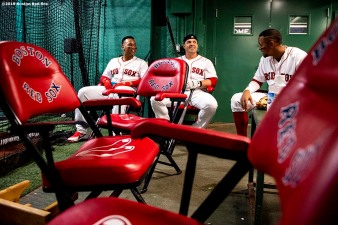 BOSTON, MA - APRIL 25: Rafael Devers #11, Steve Pearce #25, and Xander Bogaerts #2 of the Boston Red Sox sit in the batting cage before a game against the Detroit Tigers on April 25, 2019 at Fenway Park in Boston, Massachusetts. (Photo by Billie Weiss/Boston Red Sox/Getty Images) *** Local Caption *** Rafael Devers; Steve Pearce; Xander Bogaerts
