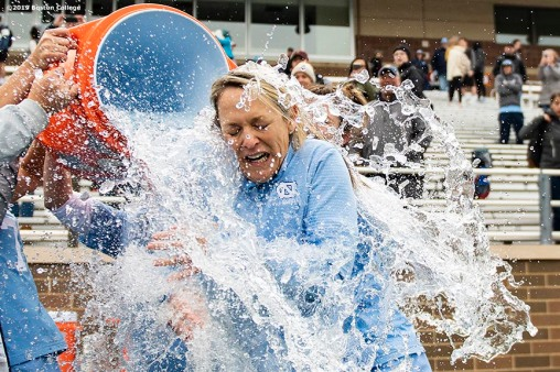April 28, 2019 , Chestnut Hill, MA: University of North Carolina coach Jenny Levy is doused with water after a victory in the 2019 Women's Lacrosse ACC Championship game against Boston College at Alumni Stadium in Chestnut Hill, Massachusetts Sunday, April 28, 2019. (Photo by Billie Weiss/Boston College)