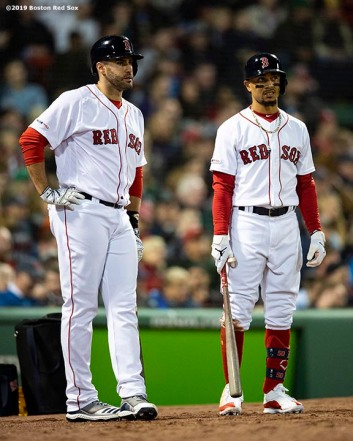 BOSTON, MA - APRIL 29: J.D. Martinez #28 and Mookie Betts #50 of the Boston Red Sox look on during the third inning of a game against the Oakland Athletics on April 29, 2019 at Fenway Park in Boston, Massachusetts. (Photo by Billie Weiss/Boston Red Sox/Getty Images) *** Local Caption *** J.D. Martinez; Mookie Betts