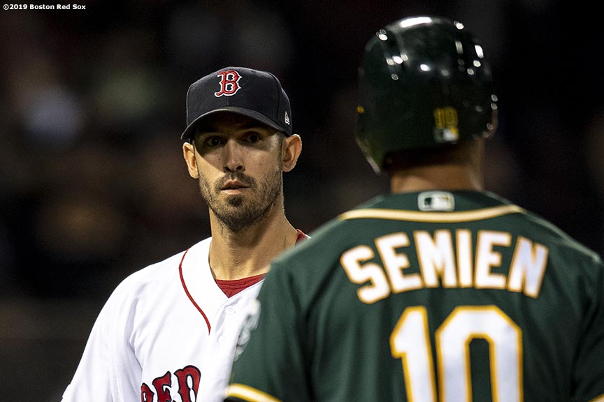 BOSTON, MA - APRIL 30: Rick Porcello #22 of the Boston Red Sox reacts with Marcus Semien #10 of the Oakland Athletics during the eight inning of a game on April 30, 2019 at Fenway Park in Boston, Massachusetts. (Photo by Billie Weiss/Boston Red Sox/Getty Images) *** Local Caption *** Rick Porcello; Marcus Semien
