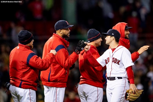 BOSTON, MA - APRIL 30: Andrew Benintendi #16 high fives David Price #24 of the Boston Red Sox as they celebrate a victory against the Oakland Athletics on April 30, 2019 at Fenway Park in Boston, Massachusetts. (Photo by Billie Weiss/Boston Red Sox/Getty Images) *** Local Caption *** Andrew Benintendi; David Price
