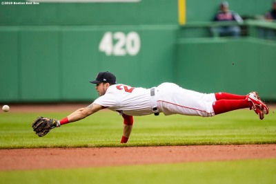 BOSTON, MA - MAY 1: Michael Chavis #23 of the Boston Red Sox dives for a ground ball during the first inning of a game against the Oakland Athletics on May 1, 2019 at Fenway Park in Boston, Massachusetts. (Photo by Billie Weiss/Boston Red Sox/Getty Images) *** Local Caption *** Michael Chavis