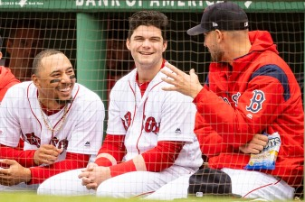 BOSTON, MA - MAY 1: Mookie Betts #50, Andrew Benintendi #16, and Rick Porcello #22 of the Boston Red Sox react during the second inning of a game against the Oakland Athletics on May 1, 2019 at Fenway Park in Boston, Massachusetts. (Photo by Billie Weiss/Boston Red Sox/Getty Images) *** Local Caption *** Mookie Betts; Rick Porcello; Andrew Benintendi