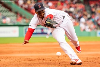 BOSTON, MA - MAY 1: Rafael Devers #11 of the Boston Red Sox reaches for a ground ball during the ninth inning of a game against the Oakland Athletics on May 1, 2019 at Fenway Park in Boston, Massachusetts. (Photo by Billie Weiss/Boston Red Sox/Getty Images) *** Local Caption *** Rafael Devers