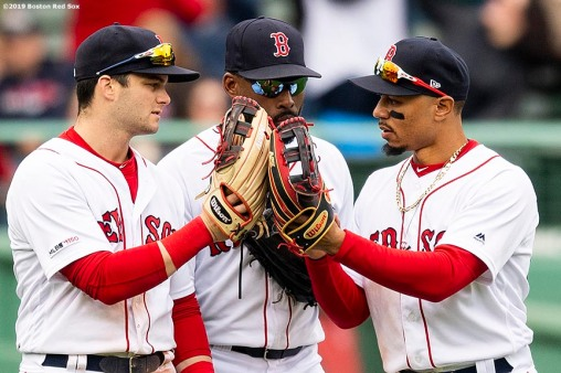 BOSTON, MA - MAY 1: Andrew Benintendi #16, Jackie Bradley Jr. #19, and Mookie Betts #50 of the Boston Red Sox celebrate a victory against the Oakland Athletics on May 1, 2019 at Fenway Park in Boston, Massachusetts. (Photo by Billie Weiss/Boston Red Sox/Getty Images) *** Local Caption *** Andrew Benintendi; Mookie Betts; Jackie Bradley Jr.