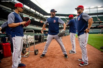 BALTIMORE, MD - MAY 7: Mookie Betts #50, J.D. Martinez #28, and Michael Chavis #23 of the Boston Red Sox talk before a game against the Baltimore Orioles on May 7, 2019 at Oriole Park at Camden Yards in Baltimore, Maryland. (Photo by Billie Weiss/Boston Red Sox/Getty Images) *** Local Caption *** Mookie Betts; J.D. Martinez; Michael Chavis