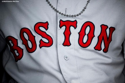 BALTIMORE, MD - MAY 7: The necklace of Andrew Benintendi #16 of the Boston Red Sox is shown before a game against the Baltimore Orioles on May 7, 2019 at Oriole Park at Camden Yards in Baltimore, Maryland. (Photo by Billie Weiss/Boston Red Sox/Getty Images) *** Local Caption *** Andrew Benintendi