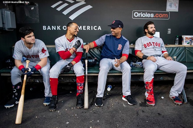 BALTIMORE, MD - MAY 7: Andrew Benintendi #16, Mookie Betts #50, manager Alex Cora, and Mitch Moreland #18 of the Boston Red Sox react in the dugout before a game against the Baltimore Orioles on May 7, 2019 at Oriole Park at Camden Yards in Baltimore, Maryland. (Photo by Billie Weiss/Boston Red Sox/Getty Images) *** Local Caption *** Andrew Benintendi; Mitch Moreland; Alex Cora; Mookie Betts