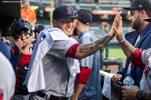 BALTIMORE, MD - MAY 7: Hector Velazquez #75 of the Boston Red Sox high fives teammates before a game against the Baltimore Orioles on May 7, 2019 at Oriole Park at Camden Yards in Baltimore, Maryland. (Photo by Billie Weiss/Boston Red Sox/Getty Images) *** Local Caption *** Hector Velazquez