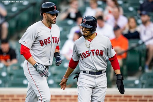 BALTIMORE, MD - MAY 7: J.D. Martinez #28 of the Boston Red Sox high fives Mookie Betts #50 after hitting a two run home run during the first inning of a game against the Baltimore Orioles on May 7, 2019 at Oriole Park at Camden Yards in Baltimore, Maryland. (Photo by Billie Weiss/Boston Red Sox/Getty Images) *** Local Caption *** J.D. Martinez; Mookie Betts