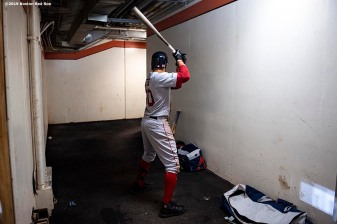 BALTIMORE, MD - MAY 7: Mookie Betts #50 of the Boston Red Sox warms up in the tunnel during the ninth inning of a game against the Baltimore Orioles on May 7, 2019 at Oriole Park at Camden Yards in Baltimore, Maryland. (Photo by Billie Weiss/Boston Red Sox/Getty Images) *** Local Caption *** Mookie Betts