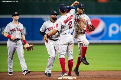 BALTIMORE, MD - MAY 7: Mookie Betts #50, Andrew Benintendi #16, Jackie Bradley Jr. #19, and Xander Bogaerts #2 of the Boston Red Sox celebrate a victory against the Baltimore Orioles on May 7, 2019 at Oriole Park at Camden Yards in Baltimore, Maryland. (Photo by Billie Weiss/Boston Red Sox/Getty Images) *** Local Caption *** Mookie Betts; Andrew Benintendi; Jackie Bradley Jr.; Xander Bogaerts