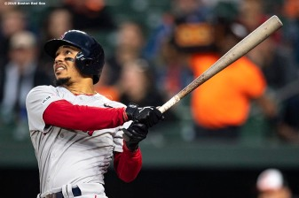 BALTIMORE, MD - MAY 8: Mookie Betts #50 of the Boston Red Sox hits a solo home run during the third inning of a game against the Baltimore Orioles on May 8, 2019 at Oriole Park at Camden Yards in Baltimore, Maryland. (Photo by Billie Weiss/Boston Red Sox/Getty Images) *** Local Caption *** Mookie Betts