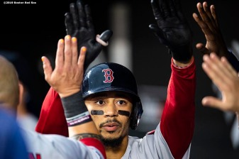 BALTIMORE, MD - MAY 8: Mookie Betts #50 of the Boston Red Sox high fives teammates fter hitting a solo home run during the third inning of a game against the Baltimore Orioles on May 8, 2019 at Oriole Park at Camden Yards in Baltimore, Maryland. (Photo by Billie Weiss/Boston Red Sox/Getty Images) *** Local Caption *** Mookie Betts