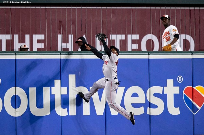 BALTIMORE, MD - MAY 8: Jackie Bradley Jr. #19 of the Boston Red Sox makes a leaping catch during the eleventh inning of a game against the Baltimore Orioles on May 8, 2019 at Oriole Park at Camden Yards in Baltimore, Maryland. (Photo by Billie Weiss/Boston Red Sox/Getty Images) *** Local Caption *** Jackie Bradley Jr.