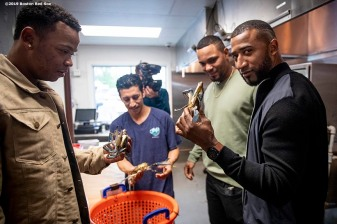 BALTIMORE, MD - MAY 8: Rafael Devers #11, Xander Bogaerts #2, and Eduardo Nunez #36 of the Boston Red Sox are given a tour of the kitchen during a visit to Nick's Fish House on May 8, 2019 in Baltimore, Maryland. (Photo by Billie Weiss/Boston Red Sox/Getty Images) *** Local Caption *** Rafael Devers; Xander Bogaerts; Eduardo Nunez