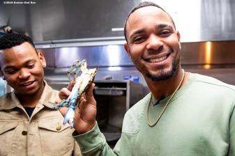 BALTIMORE, MD - MAY 8: Rafael Devers #11 and Xander Bogaerts #2 of the Boston Red Sox handle crabs in the kitchen during a visit to Nick's Fish House on May 8, 2019 in Baltimore, Maryland. (Photo by Billie Weiss/Boston Red Sox/Getty Images) *** Local Caption *** Rafael Devers, Xander Bogaerts
