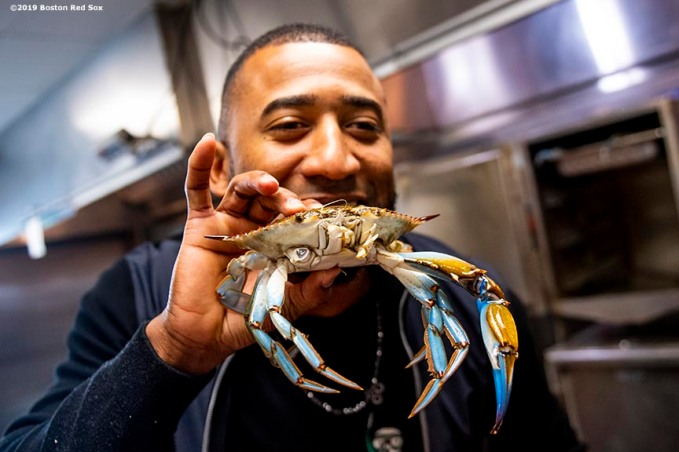 BALTIMORE, MD - MAY 8: Eduardo Nunez #36 of the Boston Red Sox holds a crab in the kitchen during a visit to Nick's Fish House on May 8, 2019 in Baltimore, Maryland. (Photo by Billie Weiss/Boston Red Sox/Getty Images) *** Local Caption *** Eduardo Nunez