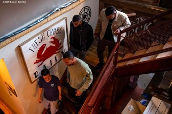 BALTIMORE, MD - MAY 8: Xander Bogaerts #2, Eduardo Nunez #36, and Rafael Devers #11 of the Boston Red Sox are given a tour during a visit to Nick's Fish House on May 8, 2019 in Baltimore, Maryland. (Photo by Billie Weiss/Boston Red Sox/Getty Images) *** Local Caption *** Xander Bogaerts; Eduardo Nunez; Rafael Devers