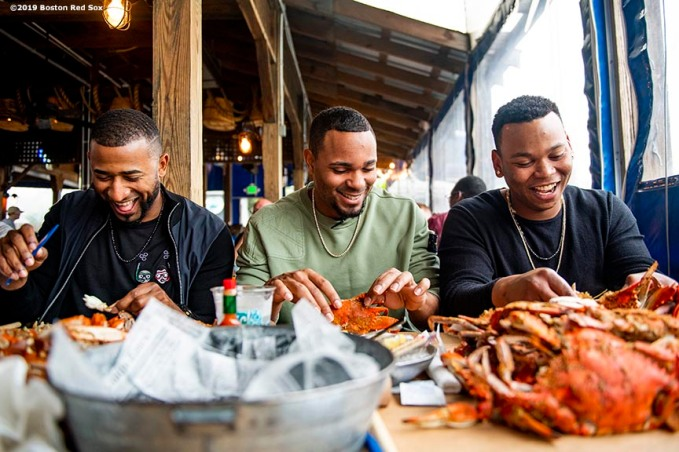 BALTIMORE, MD - MAY 8: Eduardo Nunez #36, Xander Bogaerts #2, and Rafael Devers #11 of the Boston Red Sox eat crabs during a visit to Nick's Fish House on May 8, 2019 in Baltimore, Maryland. (Photo by Billie Weiss/Boston Red Sox/Getty Images) *** Local Caption *** Eduardo Nunez; Xander Bogaerts; Rafael Devers