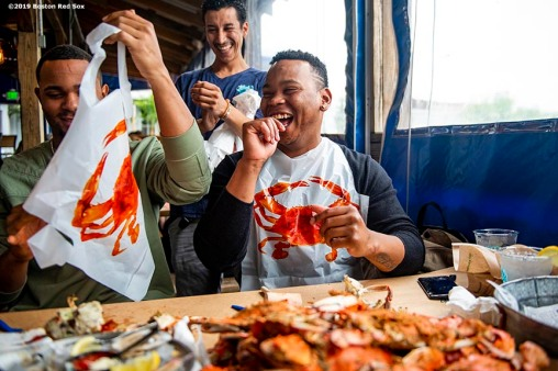 BALTIMORE, MD - MAY 8: Xander Bogaerts #2 and Rafael Devers #11 of the Boston Red Sox react as they eat crabs during a visit to Nick's Fish House on May 8, 2019 in Baltimore, Maryland. (Photo by Billie Weiss/Boston Red Sox/Getty Images) *** Local Caption *** Xander Bogaerts; Rafael Devers