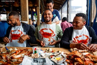 BALTIMORE, MD - MAY 8: Eduardo Nunez #36, Xander Bogaerts #2, and Rafael Devers #11 of the Boston Red Sox put on bibs as they eat crabs during a visit to Nick's Fish House on May 8, 2019 in Baltimore, Maryland. (Photo by Billie Weiss/Boston Red Sox/Getty Images) *** Local Caption *** Eduardo Nunez; Xander Bogaerts; Rafael Devers