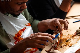BALTIMORE, MD - MAY 8: Xander Bogaerts #2 of the Boston Red Sox eats crabs during a visit to Nick's Fish House on May 8, 2019 in Baltimore, Maryland. (Photo by Billie Weiss/Boston Red Sox/Getty Images) *** Local Caption *** Xander Bogaerts