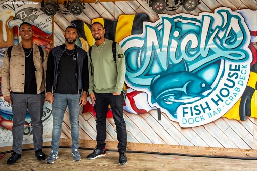 BALTIMORE, MD - MAY 8: Rafael Devers #11, Eduardo Nunez #36, and Xander Bogaerts #2 of the Boston Red Sox pose for a photograph during a visit to Nick's Fish House on May 8, 2019 in Baltimore, Maryland. (Photo by Billie Weiss/Boston Red Sox/Getty Images) *** Local Caption *** Rafael Devers; Eduardo Nunez; Xander Bogaerts