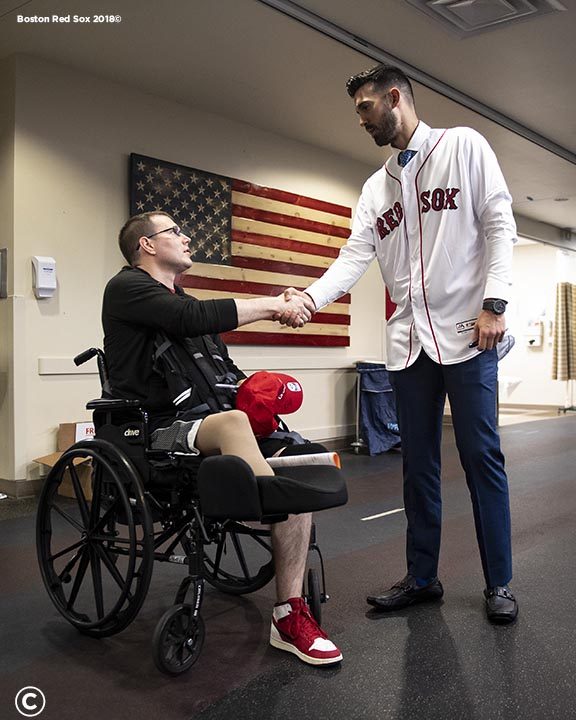 WASHINGTON, DC - MAY 9: Rick Porcello #22 of the Boston Red Sox greets a patient during a visit to Walter Reed National Military Medical Center on May 9, 2019 in Washington, DC. (Photo by Billie Weiss/Boston Red Sox/Getty Images) *** Local Caption *** Rick Porcello