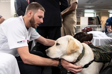 WASHINGTON, DC - MAY 9: Chris Sale #41 of the Boston Red Sox is greeted by dog Sully H.W. Bush during a visit to Walter Reed National Military Medical Center on May 9, 2019 in Washington, DC. (Photo by Billie Weiss/Boston Red Sox/Getty Images) *** Local Caption *** Chris Sale; Sully H.W. Bush