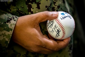 WASHINGTON, DC - MAY 9: A guest holds an autographed baseball during a Boston Red Sox visit to Walter Reed National Military Medical Center on May 9, 2019 in Washington, DC. (Photo by Billie Weiss/Boston Red Sox/Getty Images) *** Local Caption ***