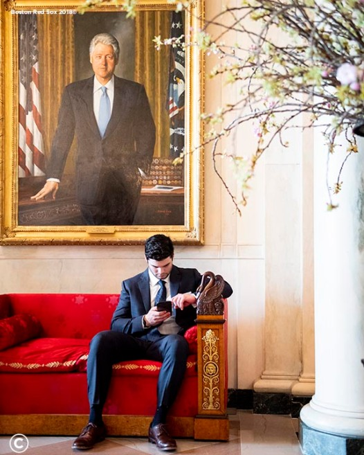 WASHINGTON, DC - MAY 9: Andrew Benintendi #16 of the Boston Red Sox relaxes under a portrait of Bill Clinton during a visit to the White House in recognition of the 2018 World Series championship on May 9, 2019 in Washington, DC. (Photo by Billie Weiss/Boston Red Sox/Getty Images) *** Local Caption *** Andrew Benintendi
