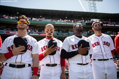 BOSTON, MA - MAY 11: Andrew Benintendi #16, Mookie Betts #50, Jackie Bradley Jr. #19, and J.D. Martinez #28 of the Boston Red Sox look on before a game against the Seattle Mariners on May 11, 2019 at Fenway Park in Boston, Massachusetts. (Photo by Billie Weiss/Boston Red Sox/Getty Images) *** Local Caption *** Andrew Benintendi; Mookie Betts; Jackie Bradley Jr.; J.D. Martinez