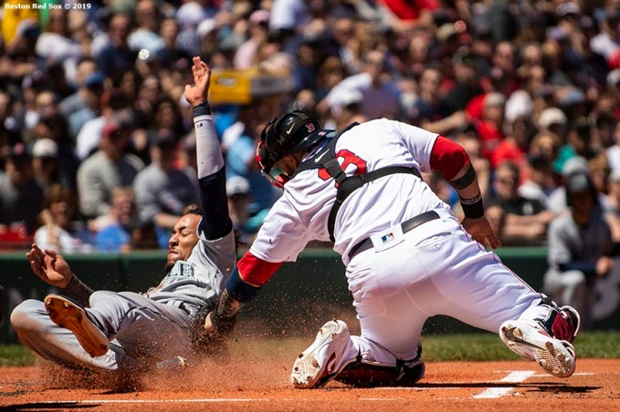 BOSTON, MA - MAY 11: J.P. Crawford #3 of the Seattle Mariners slides as he avoids the tag of Sandy Leon #3 of the Boston Red Sox to score during the first inning of a game on May 11, 2019 at Fenway Park in Boston, Massachusetts. (Photo by Billie Weiss/Boston Red Sox/Getty Images) *** Local Caption *** J.P. Crawford; Sandy Leon