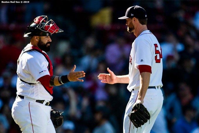 BOSTON, MA - MAY 11: Colten Brewer #54 of the Boston Red Sox and Sandy Leon #3 celebrate a victory against the Seattle Mariners on May 11, 2019 at Fenway Park in Boston, Massachusetts. (Photo by Billie Weiss/Boston Red Sox/Getty Images) *** Local Caption *** Colten Brewer; Sandy Leon