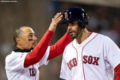 BOSTON, MA - MAY 14: J.D. Martinez #28 of the Boston Red Sox has his helmet removed by Mookie Betts #50 hitting a solo homer during the third inning of a game against the Colorado Rockies on May 14, 2019 at Fenway Park in Boston, Massachusetts. (Photo by Billie Weiss/Boston Red Sox/Getty Images) *** Local Caption *** J.D. Martinez; Mookie Betts