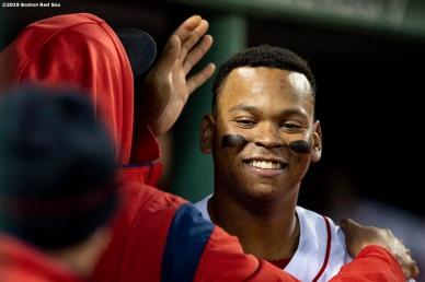 BOSTON, MA - MAY 14: Rafael Devers #11 of the Boston Red Sox reacts after hitting a solo homer during the third inning of a game against the Colorado Rockies on May 14, 2019 at Fenway Park in Boston, Massachusetts. (Photo by Billie Weiss/Boston Red Sox/Getty Images) *** Local Caption *** J.D. Martinez