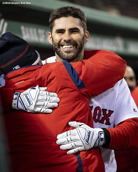 BOSTON, MA - MAY 14: J.D. Martinez #28 of the Boston Red Sox hugs Brock Holt #12 after hitting a solo home run during the third inning of a game against the Colorado Rockies on May 14, 2019 at Fenway Park in Boston, Massachusetts. (Photo by Billie Weiss/Boston Red Sox/Getty Images) *** Local Caption *** J.D. Martinez; Brock Holt
